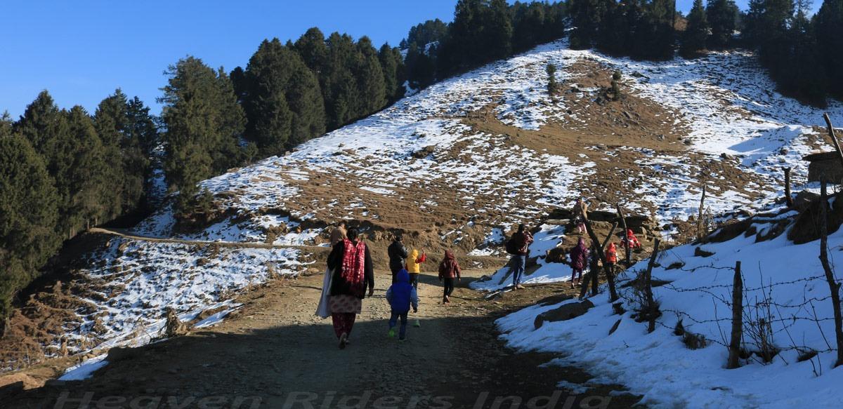 Family hiking towards Prashar Lake